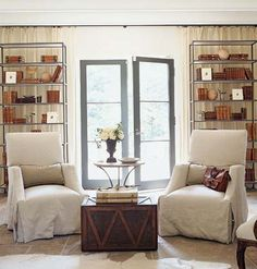 The shelving and coffee table punch up the two comfortable chairs, and the doors to the garden are inviting.