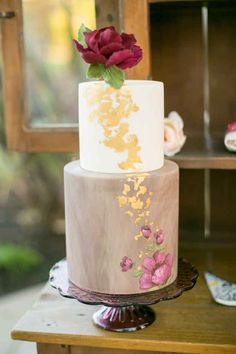 This romantic, two-tiered cake with flowers.
