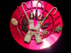 Chocolate-dipped spoons & candy canes, and marshmallow snowmen for coffee and hot cocoa.