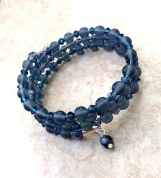 A personal favorite from my Etsy shop https://www.etsy.com/listing/237449477/deep-blue-memory-wire-bracelet-montana