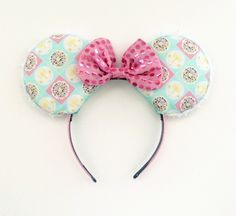A personal favorite from my Etsy shop https://www.etsy.com/listing/271040655/small-world-ears-small-world-mickey-ears