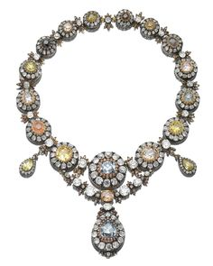 A SUPERB SUITE OF IMPERIAL JEWELS, A MAGNIFICENT AND UNIQUE DIAMOND PARURE, MID 19TH CENTURY. Diamonds and colored diamonds, circa mid 19th century. Legendary connection with Peter the Great of Russia, see source notes and provenance for further details.