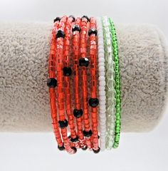 This adorable watermelon wrap bracelet is made on 9 rows of silver memory wire with glass beads, crystals, and glass Czech fire polished beads and is the perfect accessory to wear this summer! ★ Return to my main shop page here for more inventory ★ Beaded Anklets, Beaded Wrap Bracelets, Seed Bead Bracelets, Seed Bead Jewelry, Memory Wire Jewelry, Memory Wire Bracelets, Wire Wrapped Jewelry, Hippie Bracelets, Hippie Jewelry