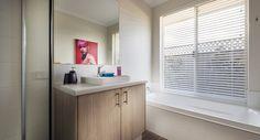 Stylish bathrooms with semi-inset vanity basins, mixer taps and glass semi-frameless pivot screen doors