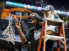 Michigan State Spartans center Adreian Payne (5) cuts down the net with 8 year old cancer patient Lacey Hollsworth after defeating the Michi...