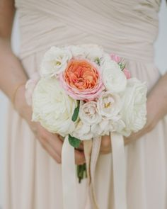 These bridesmaids carried bouquets of white roses and pink begonias with champagne-hued ribbon that gave the blooms a romantic feel. Check out this glamourous garden-party wedding in San Francisco!
