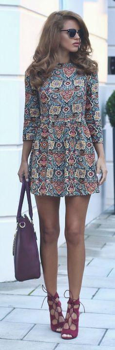 Nada Adelle rocks a statement folk dress and edgy pink stilettos. Dress: Ark, Heels: Public Desire.