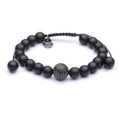This is a beautiful Black Onyx CZ Charm bracelet. The Black Onyx is associated primarily with the root chakra. It assists with challenges in life, especially those caused by a drain of energy. It prevents the draining away of personal energy and can be used for protection, It blocks negative energies.