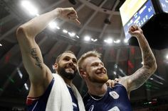 Italy's Osmany Juantorena, left, and Ivan Zaytsev celebrate a win after a men's semifinal volleyball match against the United States at the 2016 Summer Olympics in Rio de Janeiro, Brazil, Friday, Aug. 19, 2016. (AP Photo/Matt Rourke)