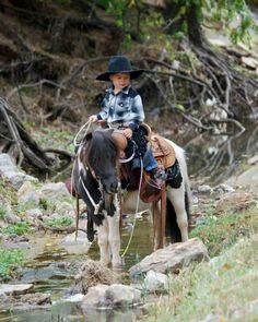 A miniature cowboy on a miniature horse. We love it! #TooCuteForWords #LittleCowboy #MiniHorse
