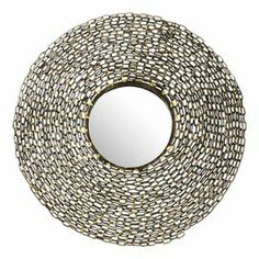 "Round wall mirror with a coiled chain-link frame.   Product: Wall mirrorConstruction Material: Iron, engineered wood and mirrored glassColor: Silver and goldDimensions: 24"" Diameter  x 3.5"" D"