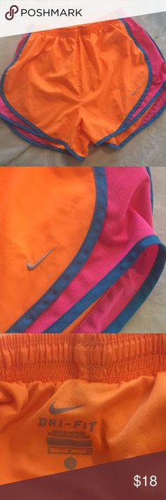 Nike dry tempo running shorts Nike dry tempo dri-fit running shorts. Size small. Colors are neon orange, with pink and blue trim. Very vibrant, fun colors! The drawstring has been pulled through on one side, but can be discarded or pulled back through, if you'd like (see last photo).  Otherwise, no signs of wear Nike Shorts