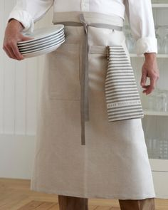 "Inspiration: Café Apron In Oatmeal (Studiopatró) | Inspired by men who love to cook, and designed to fit both women and men comfortably. It's long and wide and universally just looks good. The linen/cotton blend is finished with sturdy nickel-plated grommets on the back corners, and slate gray cotton twill ties. 33"" long, 40"" wide."