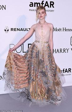 Elegant attire: Elle worked her magic as she made her grand entrance, showcasing the stunning dress to its best advantage