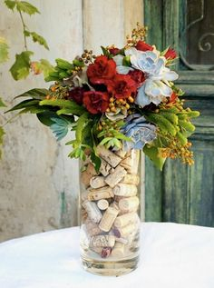 Fun DIY party decoration - save up your wine corks and fill tall glass vases as a centerpiece. Lovely!
