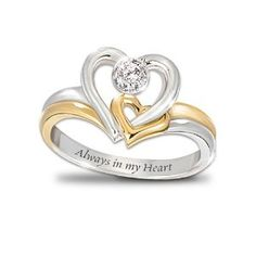 Always In My Heart Engraved Heart-Shaped Diamond Ring: Romantic Jewelry Gift For Her by The Bradford Exchange; Amazon description: No union is more perfect, more complete or more filled with love than the union between two intertwined hearts. Now, an engraved heart-shaped diamond ring, a fine jewelry design available exclusively from Th...