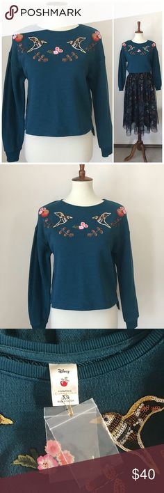 """LC Lauren Conrad Snow White embroidered top LC Lauren Conrad lightweight sweatshirt from her Disney Snow White collection. Size XS but runs large. Beautifully embroidered & embellished w/ two birds, apples & flowers. This really mirrors the nature and organic themes on the runways last year. Deep teal color. Extra baggies of beads. Armpit to armpit is 19"""". High- low hem. Raglan sleeve. Back measurements from collar to hem, 20"""". Front measurements from collar to hem approximately 18.5"""". Never…"""
