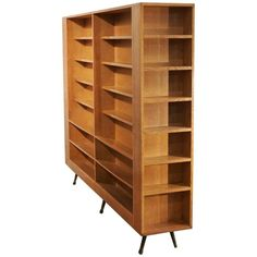 Oak Midcentury Separation Bookshelve   From a unique collection of antique and modern bookcases at https://www.1stdibs.com/furniture/storage-case-pieces/bookcases/