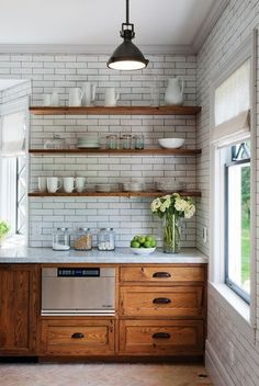 A little bit lighter but still rustic wood and brick tiles for a background really enhance the marble countertops. They seem to class up the wood while the wood helps to tone down the marble. It's an ideal balance.