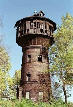 Architecture - Abandoned Places - Abandoned water tower in the Polish village of Lubne, Lesko County. It serviced the village until the when it was converted into a home. It's been abandoned for many years now. Abandoned Buildings, Abandoned Mansions, Old Buildings, Abandoned Places, Abandoned Castles, Office Buildings, Beautiful Buildings, Beautiful Places, Haunted Places