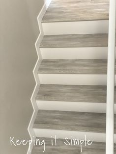 gray stairs with white risers - Google Search Laminate Stairs, Grey Laminate, Beige Carpet, New Carpet, White Stair Risers, Beach Stairs, Pergo Outlast, Stair Nosing, Carpet Stairs