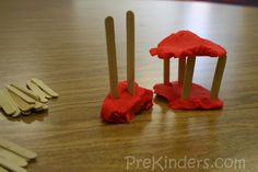 Art Centers- Wooden craft sticks can be added to the play dough for children to construct houses and other buildings. From prekinders.com