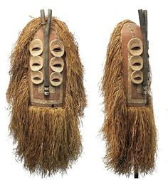 Africa | An Elanda mask from the Bembe people of DR Congo | Elanda masks, from the Elanda male association, most often have a rounded top and a flat bottom, with a spiritual, mysterious, but human face. Some with rounded faces are similar, but those with pointed beak-like chins and small tufts or horns represent bird or animal spirits. Several , like this one, have multiple sets of eyes. | © Tim Hamill