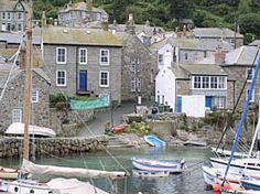 Mousehole, Cornwall. Friendly, quiet and quite beautiful. I've not seen a photo that can do justice to this place.
