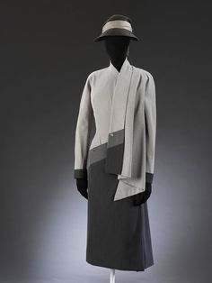 Dress  Place of origin: Paris, France (made)  Date: 1950 (made)  Artist/Maker: Jacques Fath, born 1912 - died 1954 (designer)  Materials and Techniques: Gabardine