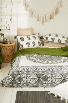 Bright up a bohemian themed room with bright green patterns. add grey and wooden accessories to complete the look. Great for bedrooms and living rooms.
