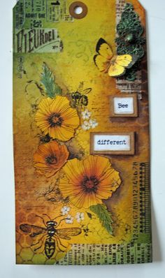 The background was inked with Wild Honey, Bundled Sage and Crushed Olives Distress Inks.