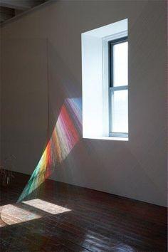Rainbow installation art with colored thread