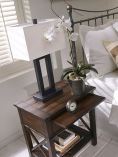 We love the brilliant geometry of our Stafford bronze table  lamp.