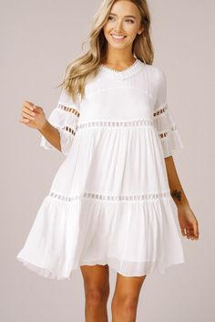 The White Linen Night bell-sleeve Babydoll Dress has a flirty flowy shape of tiered ruffles with peek-a-boo hemline. - Lined - Lace Trim - Length Bell Sleeves - V-NeckBell sleeves ruffle babydoll dress - Rayon crinkle fabric - V-neck - bell sleeves - Edgy Dress, Boho Dress, White Dress Casual, White Flowy Dress, White Linen Dresses, White Dress Summer, White Dress With Sleeves, Womens White Dress, White Frock