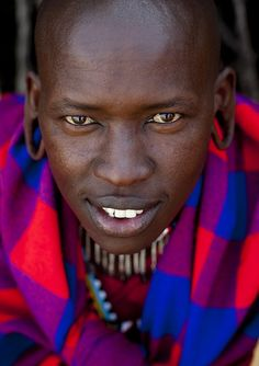 Masai warrior - Kenya. The Massai live only on the Tanzania-Kenya border, along the Great Rift Valley on semi-arid and arid lands.They have been deported from their best traditional grazing lands, that are now known as the Maasai Mara National Reserve, the Amboseli National Park, and other protected forests. The Maasai comprise 5 clans. ~by Eric Lafforgue