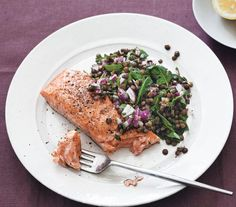 Salmon With Warm Lentil Salad | Full of fiber, protein, iron, and vitamin B, lentils are inexpensive and make a great meat substitute or side dish.