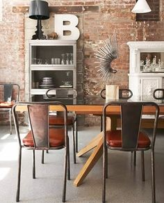 Love the vintage feel of this kitchen with its bare brick wall, miss-matched accessories and industrial seating