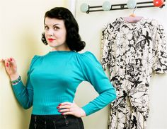 "Our famous ""saddle"" shoulder 1940's sweater in a super soft acylic, just like the original 'Orlon' by DuPont . An attractive turquoise,  long sleeves and a deep ribbed waistband to accentuate your curves., PLEASE CHECK THE SIZING CHART BELOW."