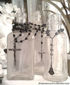 Antique Vintage Decor -display rosaries on antique bottles.love this idea. If not Catholic, you could browse your jewelry box for most any string of beads. Altered Bottles, Antique Bottles, Vintage Bottles, Bottles And Jars, Glass Bottles, Vintage Perfume, Antique Glass, Perfume Bottles, Vibeke Design