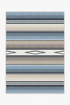 This rug takes on a contemporary twist on the classic Mexican serape blanket. The motif features ombre stripes of slate blue and pewter hues with pops of nautical blue imbuing a sophisticated accent with authentic south-of-the-border charm. Stone Rug, Beige, Machine Washable Rugs, Turquoise Rug, Instagram Shop, Red Rugs, Blue Stripes, Colorful Rugs, Colors