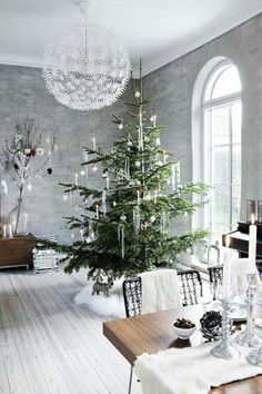 Dramatic White Christmas Decor Interior with Silver Walls and Whitewashed Wood Flooring.