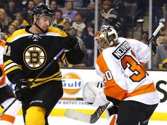 Philadelphia Flyers goalie Michal Neuvirth, right, makes a save with Boston Bruins right wing Jimmy Hayes in front during the first period in Boston.  Winslow Townson, USA TODAY Sports