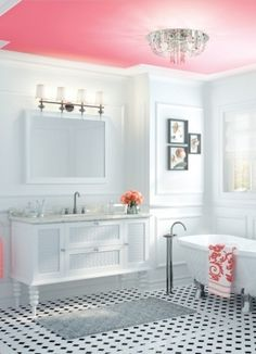 black and white bathrooms are my favorite. pop of color on ceiling is a thing to remember!