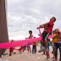 A seesaw, also known as a teetertotter, has been built at the wall between the US and Mexico in defiance of Donald Trump.
