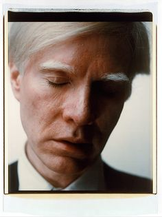 Self-portrait As always with Warhol, is this a self-portrait or is someone holding the camera.  Nice placement of his face within the frame great contrast, plus the use of his cloth (black and white)
