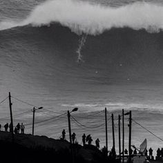 British Andrew Cotton surfing for the queen on this bomb. Amazing pic by Bruno Aleixo - Nazaré Beach - 28 de Outubro de 2013