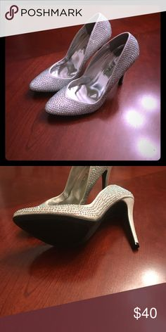 studded silver high 👠 Perfect for pageant, wedding, or prom. Shoes say 7.5 but I think sized wrong and closer to 8.5. No tags or original box, but never worn. Shoes Heels