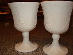 have a couple of these goblets with yellow flowers on each table with the large white hydrangea as the center pieces