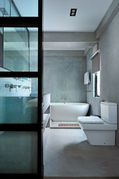 Concrete bathroom with free standng bathtub