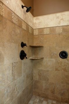 Great use of multiple sizes and colors of tile for this shower. Love the color of the plumbing for this color combo!